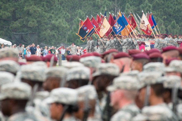"""Soldiers from the 82nd Airborne Division Sustainment Brigade render honors to the National Colors during the All American Week 2015 Airborne Review on Fort Bragg, N.C., May 20, 2015. The brigade's Soldiers replaced their Army patrol caps for the maroon beret during the review, marking the brigade's transition back to the 82nd Abn. Div. after detaching from the Division in 2008. All American Week is an opportunity for 82nd Abn. Div. paratroopers, past and present, and their families to come together and enjoy the camaraderie and celebrate being members of the All American Division. This year's All American Week theme is """"Past, Present, and Future."""" (U.S. Army photo by Staff Sgt. Charles Crail/Released)"""