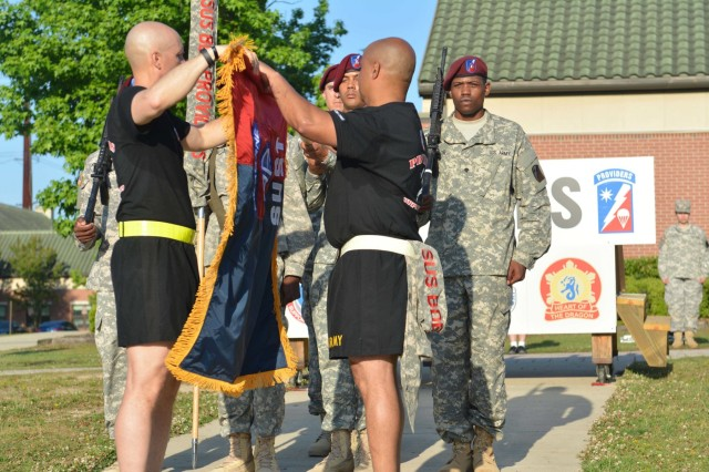 """Col. Mark Collins and Command Sgt. Maj. Ian Dames, 82nd Airborne Division Sustainment Brigade command team, uncase the brigade's new colors during a ceremony following a brigade run on Fort Bragg, N.C., May 20, 2015. The ceremony marked the transition of the brigade back to the 82nd Abn. Div. during All American Week 2015 after detaching from the Division in 2008. All American Week is an opportunity for 82nd Abn. Div. paratroopers, past and present, and their families to come together and enjoy the camaraderie and celebrate being members of the All American Division. This year's All American Week theme is """"Past, Present, and Future."""" (U.S. Army photo by Staff Sgt. Adam C. Keith, 82nd Abn. Div. Sus. Bde./Released)"""