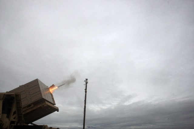 A missile is launched from the Indirect Fire Protection Capability Increment 2-Intercept Block 1 multimission launcher demonstrator. The test involved several ballistic test of various missile types to see how the launcher's missile tubes would hold up under the real world stress of a missile launch.