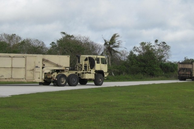Terminal High Altitude Area Defense equipment, from Battery D, 2nd Air Defense Artillery Regiment, convoys back to Site Armadillo, shortly after the passing of Typhoon Dolphin.