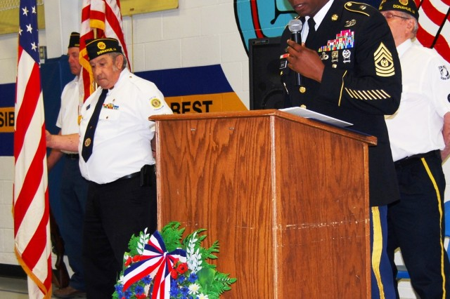 Command Sgt. Maj. Anthony Bryant, U.S. Army Sustainment Command, speaks at a Memorial Day observance held at John Glenn Elementary School in Donahue, Iowa, May 25. (Photo by Paul Levesque, ASC Public Affairs)