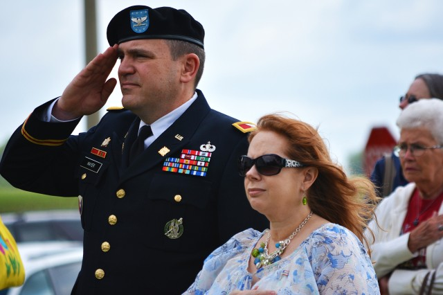 Col. Donald Mayer, chief of staff, U.S. Army Sustainment Command, renders a salute during the playing of taps at a Memorial Day service in Davenport, Iowa, May 25. (Photo by Justin Graff, ASC Public Affairs)