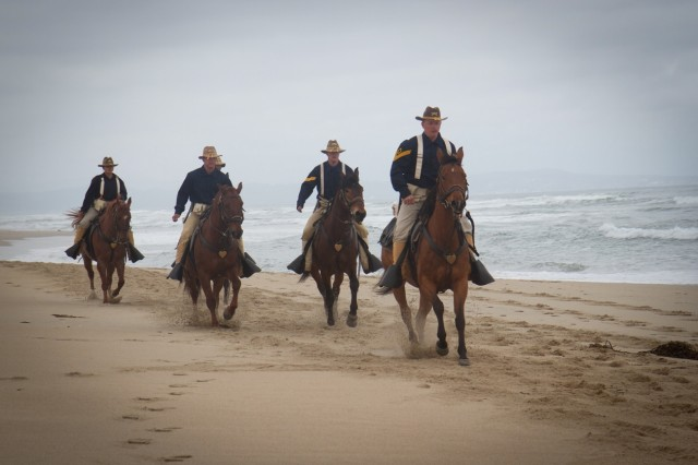 Sgt. 1st Class Roman Hacker leaders fellow Horse Handlers of the 11th Armored Cavalry Regiment Horse Detachment on a beach ride at the Salinas River State Beach in Marina, California 8 May. (Photo by Capt. Christinea Wagner, 11th ACR Public Affairs)