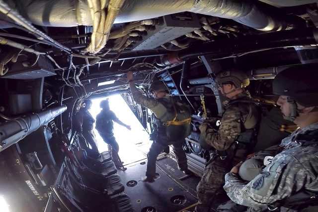 A group of U.S. Army Special Forces Soldiers recently partnered with Marine Corps aviators on Okinawa to conduct static line and military-freefall parachute operations from MV-22 Osprey military aircraft using the drop zone on Ie Shima island.