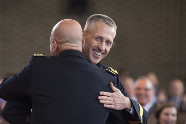 Maj. Gen. Paul K. Hurley embraces Lt. Gen. H.R. McMaster during his promotion to 24th U.S. Army Chief of Chaplains in the Memorial Chapel on the Fort Myer portion of Joint Base Myer-Henderson Hall May 22.