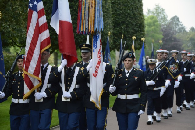 A color guard from the 2nd Signal Brigade marches in to present the U.S. and French colors at a Memorial Day ceremony May 24, 2015 at the Normandy American Cemetery in France. (U.S. Army photo by Staff Sgt. Brian Cline, 5th Signal Command Public Affairs)