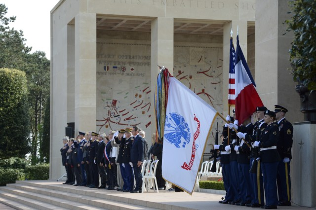 A color guard from the 2nd Signal Brigade presents the U.S. and French colors at a Memorial Day ceremony May 24, 2015 at the Normandy American Cemetery in France. (U.S. Army photo by Staff Sgt. Brian Cline, 5th Signal Command Public Affairs)