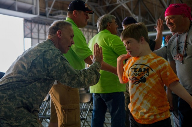 Lt. Gen. Stephen R. Lanza, commanding general of I Corps, welcomes athletes of the 2015 Washington Special Olympics to the opening ceremony at Joint Base Lewis-McChord, Wash., May 29. The Special Olympics are modeled after the Olympic Games and give people with disabilities the opportunity to compete against their peers. (U.S. Army photo by Sgt. Youtoy R. Martin, 19th Public Affairs Detachment / Released)