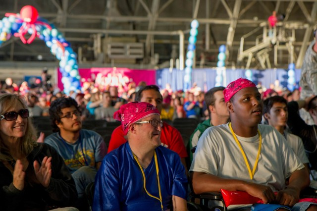 Athletes of the 2015 Washington Special Olympics attend the opening ceremony in preparation for the games at Joint Base Lewis-McChord, Wash., May 29. The Special Olympics are modeled after the Olympic Games and give people with disabilities the opportunity to compete against their peers. (U.S. Army photo by Sgt. Youtoy R. Martin, 19th Public Affairs Detachment / Released)