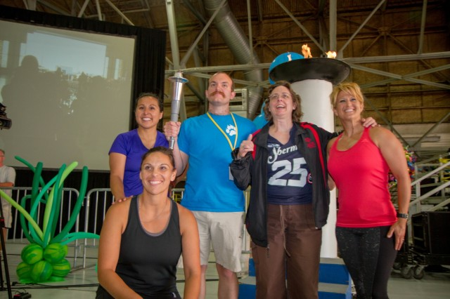Scott Anger and Kristie Clark (Center), the 2015 official athlete torch bearers, are joined by police officers Lyn Thorn, Claudia Padilla and Ileanna Salinas from the Yakima Police Department for a photo after lighting the Flame of Hope pillar. The Special Olympics are modeled after the Olympic Games and give people with disabilities the opportunity to compete against their peers. (U.S. Army photo by Sgt. Youtoy R. Martin, 19th Public Affairs Detachment / Released)