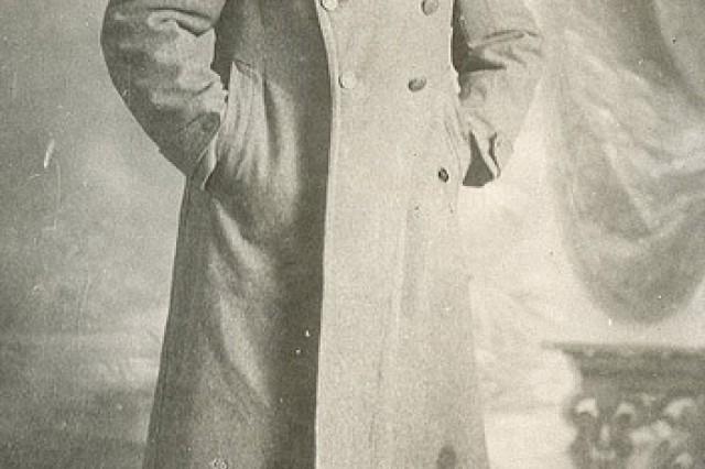 Portrait of Sgt. William Shemin in uniform overcoat is shown.