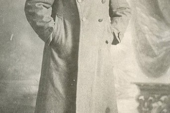 Portrait of Sgt. William Shemin in uniform overcoat is shown.