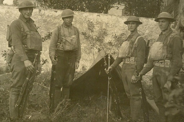 Sgt. William Shemin, far left, is shown standing with other Soldiers in front of a pup tent.