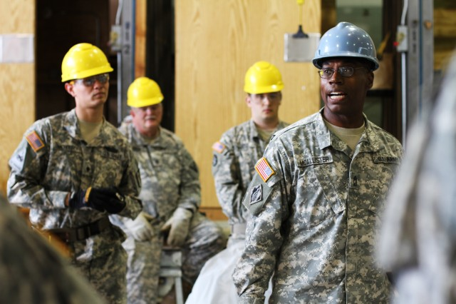 Master Sgt. Darrell McAllister, a course manager for the carpentry and masonry course, Fort Dix, N.J., teaches proper techniques for building a structural foundation during the two-week re-classification course which trains soldiers in the basic fundamentals of construction.  23 MAY 15