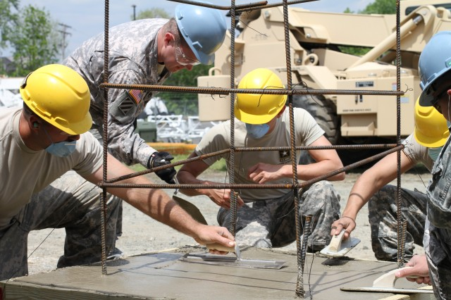 Soldiers from across the country learn the fundamentals of carpentry and masonry, such as pouring concrete and building a structural foundation, in the 80th Training Command's two-week course taught at Fort Dix, New Jersey. 23-24 MAY 15.