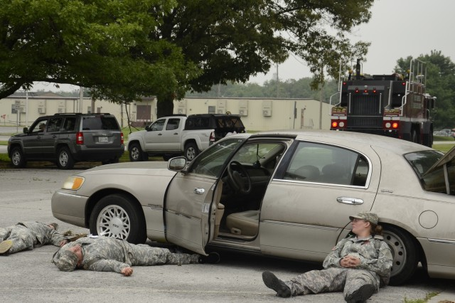 Injured and dead Soldiers wait for assistance in a parking lot off C Avenue on Fort Campbell, Tuesday morning, at the beginning of the full-scale weather-related exercise.