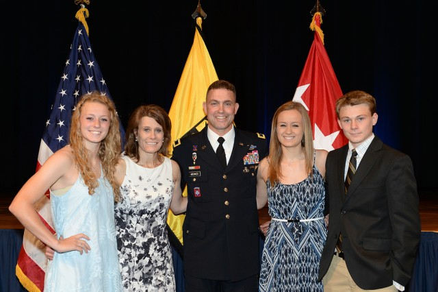 Newly promoted U.S. Army Brigadier General Brian Mennes (center) with his family (right to left) daughter Haley, wife Kellie, daughter Ashley, and son Jake.