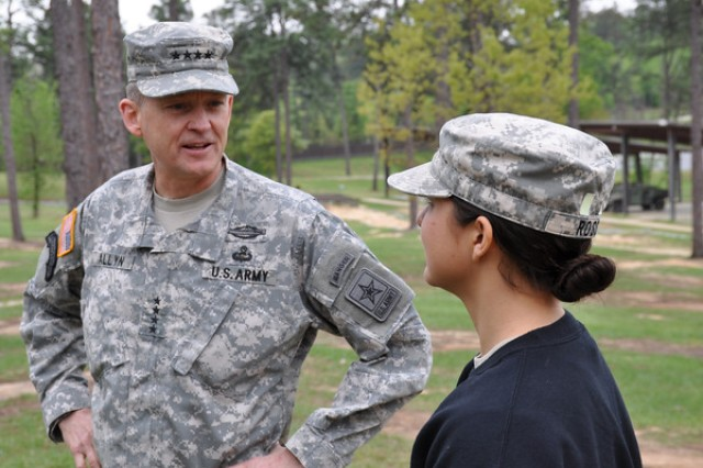 1st Lt. Tracy Ross, 205th MI BN, 500th MI Bde, right, an observer-adviser at the Ranger Training Brigade, delivers a gender-integration update to Gen. Daniel B. Allyn, vice chief of staff, U.S. Army, April 11, at the Warrior Training Center in Fort Benning, Georgia.