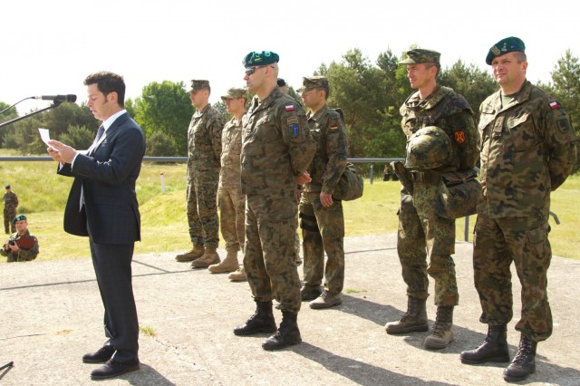 Leaders, from Exercise Saber Strike 15, address exercise participants at the Drawsko Pomorskie Training Area in Poland, June 8, 2015.