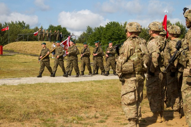 U.S., Polish, German and Danish Soldiers participate in the opening ceremony of Saber Strike 15, a multinational training exercise at the Drawsko Pomorskie Training Area in Poland, June 8, 2015.