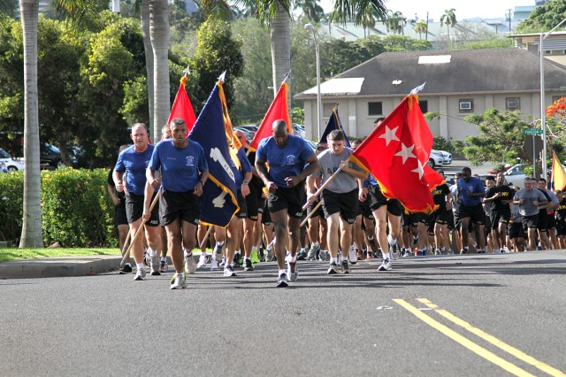 "FORT SHAFTER, Hawaii—U.S. Army Pacific Commanding General, Gen. Vincent K. Brooks alongside with USARPAC Senior Enlisted Advisor, Command Sgt. Maj. Bryant Lambert, leads the ""One Team"" ohana back to historic Palm Circle during a 1.5-mile Family Fun Run. The family fun run presented an opportunity for Soldiers, leaders, civilians and family members to strengthen bonds and increase morale. (U.S. Army photo by Staff Sgt. Kyle J. Richardson, USARPAC PAO)"