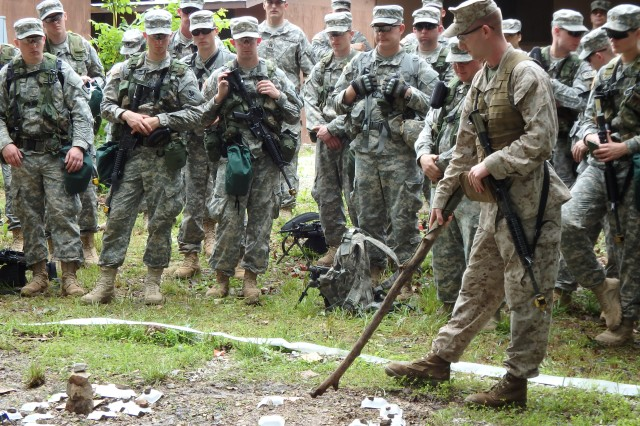 Using a pointer stick on a simulated map, a Basic Officer Leader Course student briefs his portion of the operational plan for a joint field training exercise at Fort Leonard Wood. This is the first of its kind in recent history to include the U.S. Army Engineer, Military Police and Chemical, Biological, Radiological and Nuclear Schools.