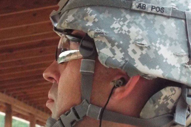 Staff Sgt. Nathan Whittenberger of Headquarters, Headquarters Company, 1st Engineering Brigade, Fort Leonard Wood, Mo., awaits his turn to fire an M16.