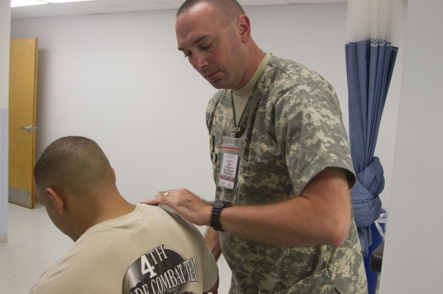 Maj. David Massing, a physical therapist at the Nelson Troop Medical Clinic, conducts an exam on a soldier to determine the affected area of an injury. Physical therapy is just one of the many services offered at the Nelson TMC at the 2015 U.S. Army Reserve Officers' Training Corps Cadet Summer Training. The Nelson TMC is open 24 hours for any sick or injured cadets and cadre.