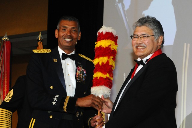 Gen. Vincent K. Brooks (left), U.S. Army Pacific commanding general, presents the Mana O Ke Koa Award to Ed Kubo, a Hawaii state judge, who was on hand to receive the award which honors individuals who have distinguished themselves by their steadfast support of Soldiers, their families and the Army community. Kubo, whose father served in the Army, shared how honored he felt to have been able to give back to the Army over the last 14 years, and how his attempts at helping were his way of giving back to the Army, to its soldiers and their families. (U.S. Army picture by Staff Sgt. Chris McCullough, U.S. Army Pacific Public Affairs)