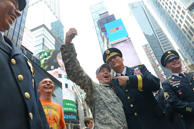 The chief of staff of the Army, Gen. Ray Odierno, poses for a photo with Sgt. Andrew Gutterman, a recruiter with the New York City Recruiting Battalion, at a celebration in New York's Times Square for the Army's 240th birthday, June 12, 2015.