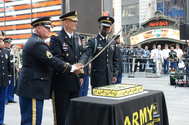 The Army celebrates its 240th birthday with events in Times Square, New York, that included a cake cutting by Army Chief of Staff Gen. Ray Odierno (center), Staff Sgt. Edimael Aponte and Spc. Michael John of New York's 1st Battalion, 69th Infantry.