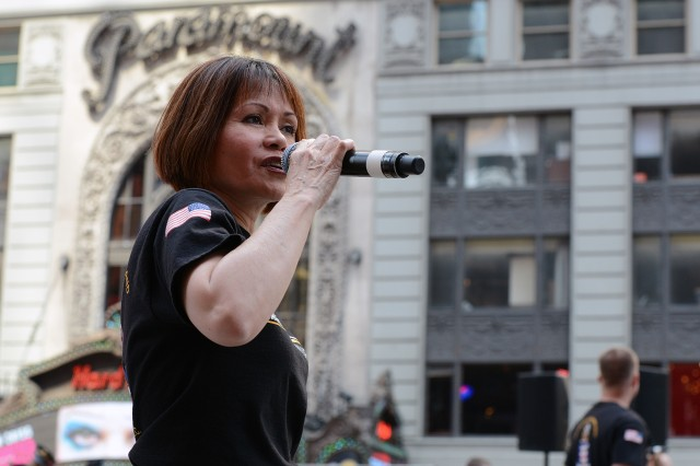 A vocalist with the U.S. Army Band Downrange performs during a celebration in New York's Times Square for the Army's 240th birthday.