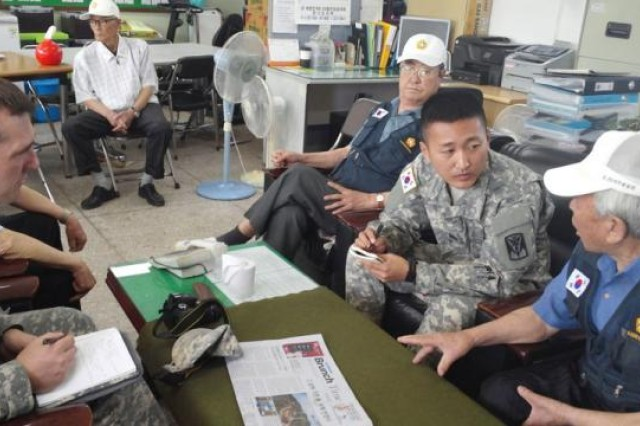 Korean Augmentee to the U.S. Army Pfc. Ho Yeon Lee, community relations specialist assigned to the 35th Air Defense Artillery Brigade, speaks with O Jae Kwon at the Ministry of Patriots and Veterans Affairs -- Osan branch June 3, 2015 to discuss Kwon's military service during the Korean War. Kwon served in the Republic of Korea Army for four years. (Photo by Hyong Uk Kim, 35th ADA community relations)