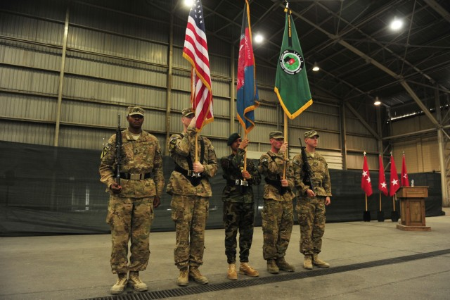 Members of the color guard stand at attention during a transfer of authority ceremony at Kandahar Airfield, Afghanistan, June 10, 2015. The 7th Infantry Division, Combined Joint Task Force - 7, under the command of Brig. Gen. Paul Bontrager, assumed responsibility for Train, Advise and Assist Command - South from the 1st Cavalry Division, Combined Joint Task Force - 1. (U.S. Military photo by Capt. Susan Harrington/Released)