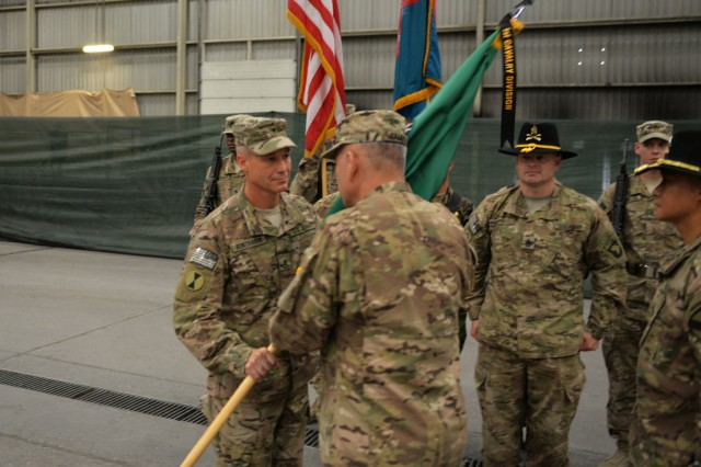 Brig. Gen. Paul Bontrager receives the colors from Gen. John Campbell signifying his assumption of command during a transfer of authority ceremony at Kandahar Airfield, Afghanistan, June 10, 2015. The 7th Infantry Division, Combined Joint Task Force - 7, assumed responsibility for Train, Advise and Assist Command - South from the 1st Cavalry Division, Combined Joint Task Force - 1. Bontrager is the commander of 7th Infantry Division, Combined Joint Task Force - 7, and Campbell is the commander of NATO-led Resolute Support mission. (U.S. Military photo by Tech. Sgt. Robert Sizelove/Released)