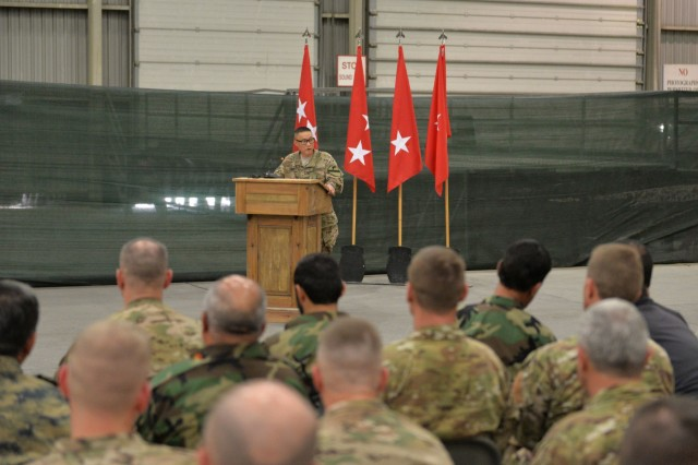 Brig. Gen. Viet Luong, the commander of the 1st Cavalry Division and outgoing commander of Train, Advise and Assist Command - South, speaks during a transfer of authority ceremony at Kandahar Airfield, Afghanistan, June 10, 2015. The 7th Infantry Division, Combined Joint Task Force - 7, under the command of Brig. Gen. Paul Bontrager, assumed responsibility for Train, Advise and Assist Command - South from the 1st Cavalry Division, Combined Joint Task Force - 1. (U.S. Military photo by Tech. Sgt. Robert Sizelove/Released)