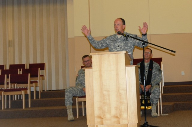 Outgoing division chaplain, Lt. Col. Paul Jaedicke (center), delivers farewell remarks during a 7th Infantry Division change of stole ceremony. Jaedicke's next assignment will be with Forces Command at Fort Bragg, N.C. overseeing chaplain plans, training and operations.