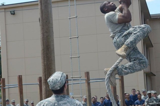 A U.S. Army Soldier with 3-2 Stryker Brigade Combat Team, 7th Infantry Division, climbs a rope during a Super Squad competition June 29, 2015, at Joint Base Lewis-McChord. This competition pitted squads from throughout the brigade against one another to see who the best was. (U.S. Army photo by Staff Sgt. Justin Naylor)