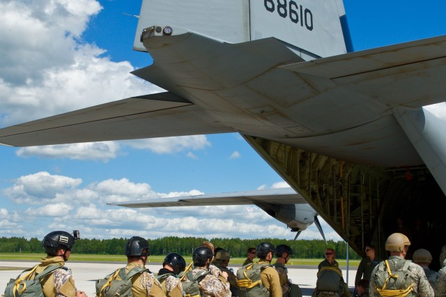 Military personnel from the Latvian National Armed Forces, U.S. Army and Air Force board a C-130J aircraft, from the 37th Airlift Squadron, 86th Airlift Wing out of Ramstein, Germany, during joint airborne training operations at Lielvarde Air Base, Latvia, June 15, 2015.