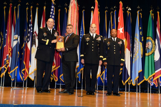 Gen. Ray Odierno, Chief of Staff of the Army, accompanied by Lt. Gen. Gustave Perna, U.S. Army Deputy Chief of Staff, G4, and Brig. Gen. Ronald Kirklin, U.S. Army Quartermaster General, presents a Supply Excellence Award to Taleh Aliyev, 509th Signal Battalion S4, at the Combined Logistics Excellence Awards ceremony June 10, 2015 at the Pentagon in Arlington, Virginia. The 509th Signal Battalion won a Supply Excellence Award, a total Army program that recognizes units for extraordinary supply and support operations, property accountability and resource management.