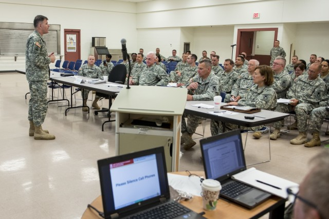 Maj. Gen. Lewis Irwin, commanding general of the 416th Theater Engineer Command (TEC), addresses his staff before the start of a briefing took part in the first of a multi-year Staff Exercise (STAFFEX) designed to implement battle drills and refine doctrinal procedures for the TEC headquarters in case of a deployment at the Parkhurst U.S. Army Reserve Center in Darien, Ill., June 12. (U.S. Army photo by Sgt. 1st Class Michel Sauret)