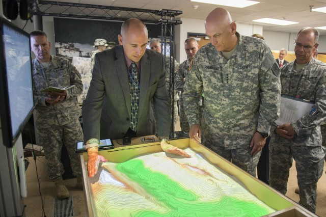 Army Chief of Staff Gen. Ray Odierno observes new innovations from labs at the U.S. Army Program Executive Office for Simulation, Training and Instrumentation in Orlando, Fla., June 15, 2015.