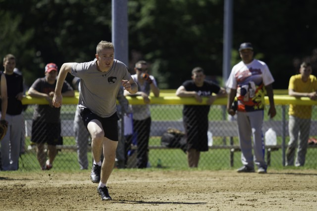 Capt. Justin Messenger, commander for C Company, 2nd Battalion, 87th Infantry Regiment, 2nd Brigade Combat Team, races to first base during the softball tournament for 10th Mountain Division (LI) Mountainfest sports day June 17 at the Magrath Sports Complex softball fields. Every year, teams from all the brigades and the Air Force squadron stationed on Fort Drum compete in various team sports to vie for Commander's Cup.