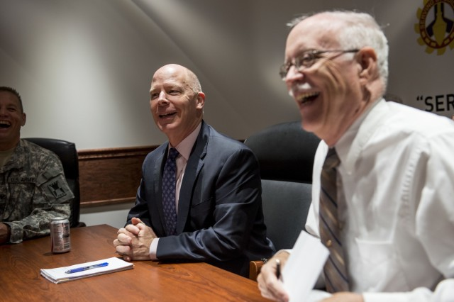James Balocki (left), chief executive officer and director of services and installations, Office of the Chief of Army Reserve, and James Murphy, command executive officer for the 416th Theater Engineer Command, laugh with staff leadership just before a briefing during Balocki's visit at the 416th TEC headquarters in Darien, Ill., June 16. Balocki oversees the Army Reserve's 12,000 civilian employes and manages the technological and physical infrastructure and military construction support for the 200,000-strong command. (U.S. Army photo by Sgt. 1st Class Michel Sauret)