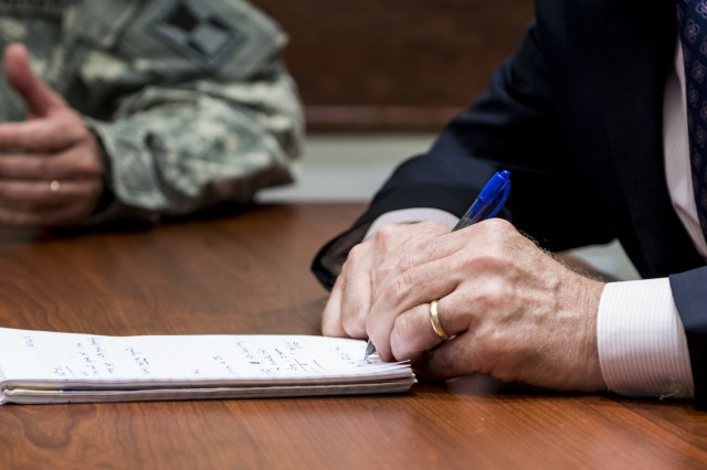 James Balocki, chief executive officer and director of services and installations, Office of the Chief of Army Reserve, writes down notes during a brief from the 416th Theater Engineer Command during a visit to their headquarters in Darien, Ill., June 16. Balocki oversees the Army Reserve's 12,000 civilian employes and manages the technological and physical infrastructure and military construction support for the 200,000-strong command. (U.S. Army photo by Sgt. 1st Class Michel Sauret)
