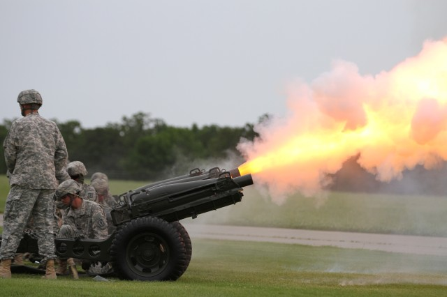 "A cannon fires during an inactivation ceremony for the 4th MEB, 1st Inf. Div., June 17 at Fort Leonard Wood's Gammon Field. ""Today we commence with inactivation, and the 'Dauntless' brigade stands ready to reawaken should the nation need us again,"" said Col. Andy Munera, commander of the 4th MEB, 1st Inf. Div., to the crowd."