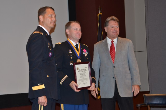 Col. Thomas Todd, center, is recognized with the Honorable Order of St. Michael silver award by Gary Nenninger, right, president of the Army Aviation Association of America Tennessee Valley Chapter. At left is Brig. Gen. Bob Marion, program executive officer for aviation.