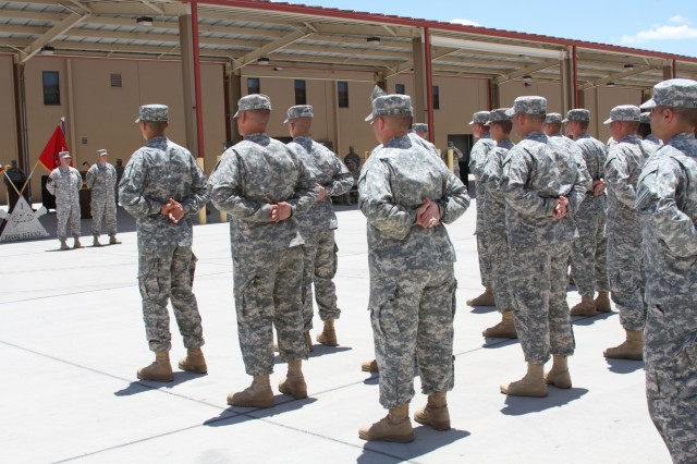 Soldiers assigned to C Battery, 4th Battalion, 27th Field Artillery Regiment, stand at parade rest prior to the start of the activation and assumption of command ceremony for the battery June 16, 2015, at Fort Bliss, Texas.  (U.S. Army photo taken by Spc. Moniqua S. Woods, 4th Battalion, 27th Field Artillery Regiment)
