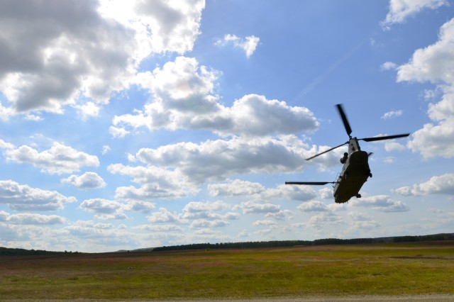 A British Royal Air Force CH-47 helicopter extracts U.S. Army paratroopers from the 173rd Airborne Brigade during a combined U.S.-Finnish air assault mission during BALTOPS 15 here June 10. BALTOPS is an annually recurring multinational exercise designed to enhance flexibility and interoperability, as well as demonstrate resolve of allied and partner forces to defend the Baltic region. (U.S. Army photo by Sgt. A.M. LaVey/173rd Abn. Bde. Public Affairs)