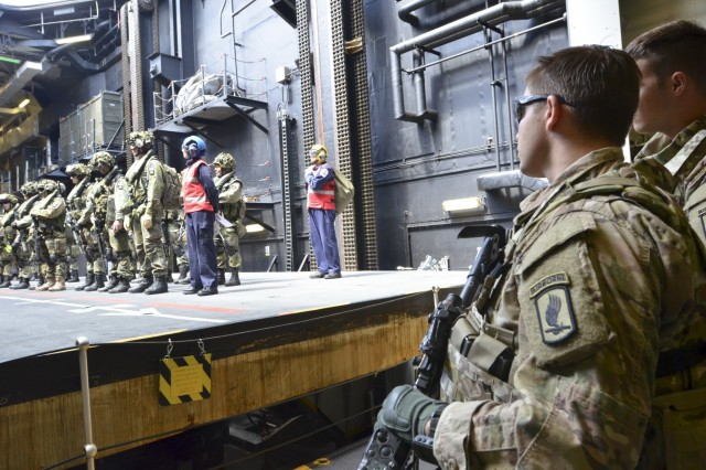 U.S. Army paratroopers from the 173rd Airborne Brigade prepare to embark on a British Royal Air Force CH-47 helicopter in order to begin a combined U.S. and Finnish air assault training mission from HMS Ocean, a British warship off the coast of Sweden, June 10, 2015 as part of BALTOPS 15. BALTOPS is an annually recurring multinational exercise designed to enhance flexibility and interoperability, as well as demonstrate resolve of allied and partner forces to defend the Baltic region. (U.S. Army photo by Sgt. A.M. LaVey/173rd Airborne Brigade PAO)